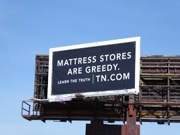 Negative Ad Tuft and Needle Billboard
